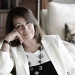 Picture of Rose Tremain wearing a white suit